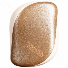 Třpytivě zlatý kompaktní kartáč